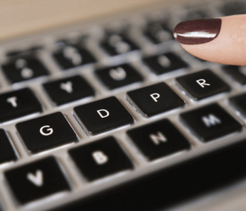 A person tying GDPR on a laptop