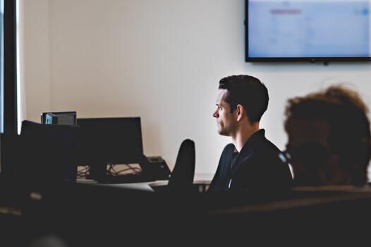 Man monitoring a system at his desk