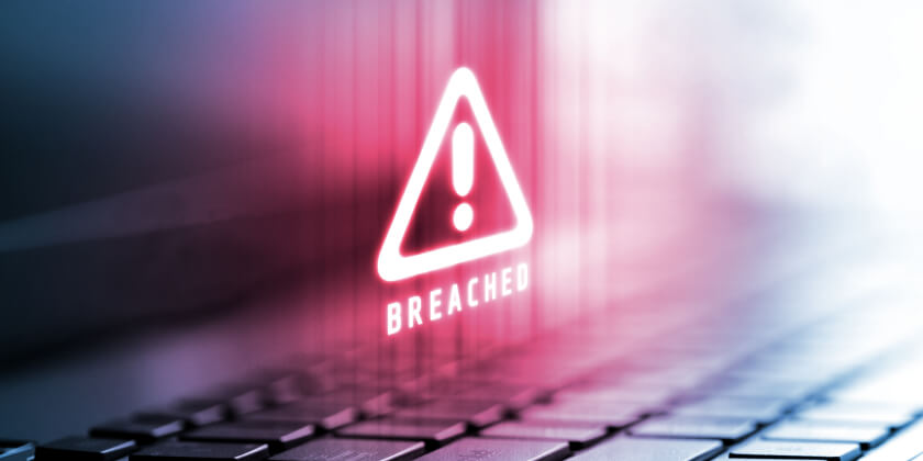 A Breached warning icon on a laptop