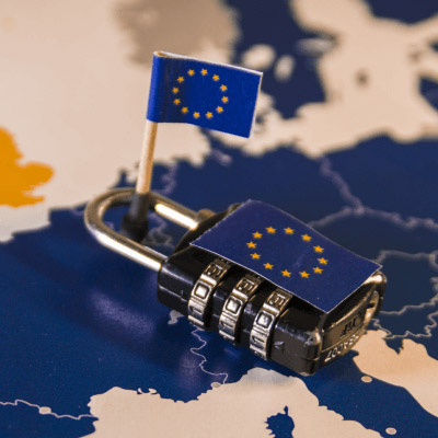 A small EU flag with a lock around it