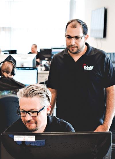 2 Bulletproof engineers at a pc