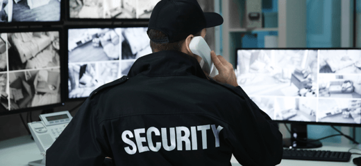 A secuity officer making a phone call from a security centre