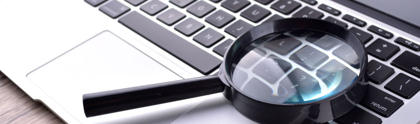 Magnifying glass on a laptop