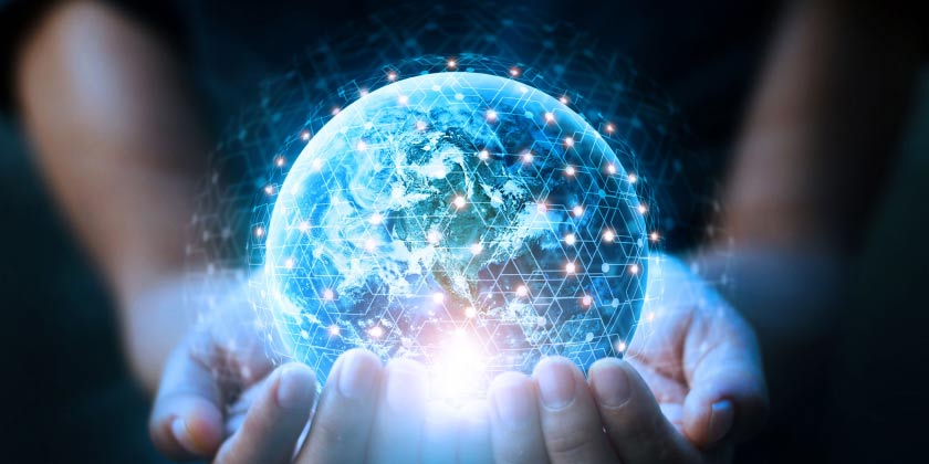 A hand holding a globe with futoristic data links
