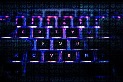 A backlit keyboard in a dark room